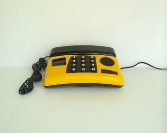 Retro yellow telephone, push button dial phone, yellow telephone