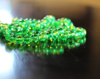 135 approx. green and yellow, 6 mm crackle glass beads, 1mm hole, round and smooth