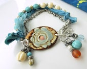 BACK2SCHOOL SALE!  Pale blue, cream, and burnt orange bracelet w/ pottery cuff bead, sari silk, and silver ox chain