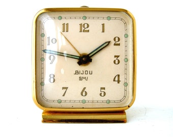 Vintage French mid century SMI 'BIJOU' square mini mechanical alarm clock. Ivory with brass detail.