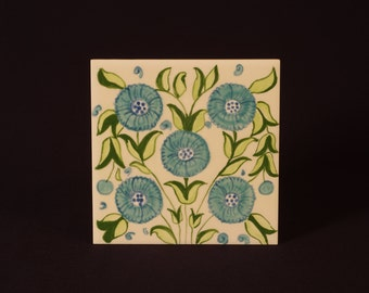 Hand painted glazed and fired ceramic tile for bathrooms,kitchens and fire surrounds.