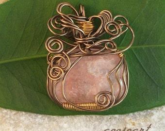 Pink quartz wire wrapped pendant
