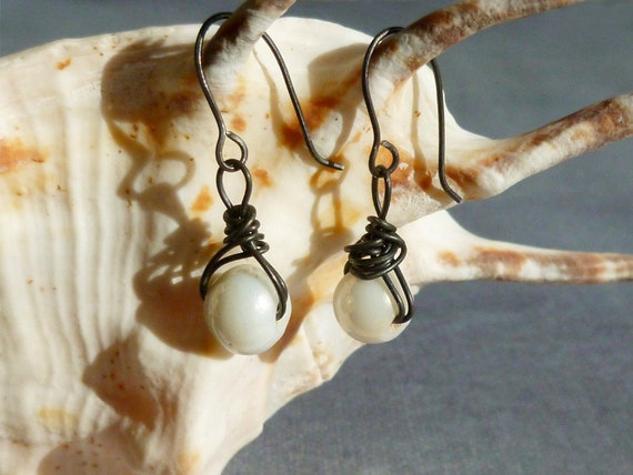 Dark steel wire earrings with white glass bead