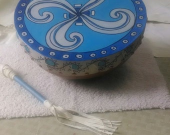 Painted drums, handcrafted from natural gourds, includes the beater.