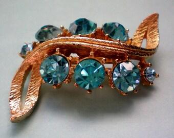 Rhinestone Swirl Brooch with Blue Stones - 1397