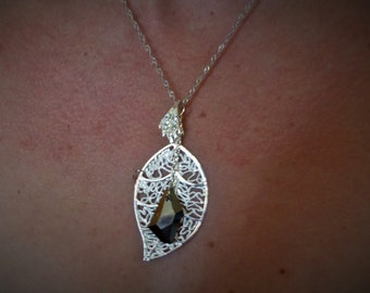 Gorgeous sterling silver leaf with a topaz pendant