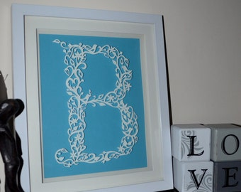individual hand cut paper initial letter B