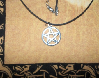 One inch.Silver Pentagram on leather