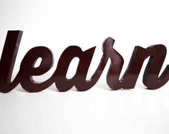 handcrafted learn wood word art