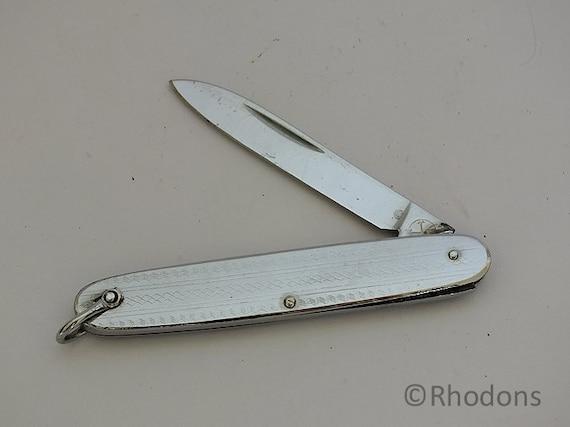 Vintage Chromed Folding Pocket Knife Crossed Arrows Trade