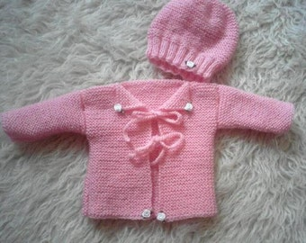 Sweet knitted baby jacket with hat in pink, enchanting