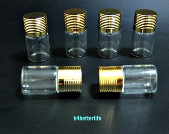 6pcs Mini Clear Glass Bottles Vials with Gold Colored Lid. H42W24. (#A27)