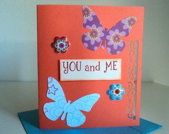 You and me in orange cardboard with butterflies and flowers