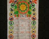 1972 Zodiac Calendar Linen Dish Towel. Orange, Unused