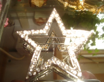 A diamante star brooch