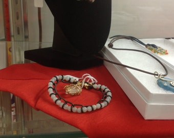 Semi pericous stone and leather cord braclet