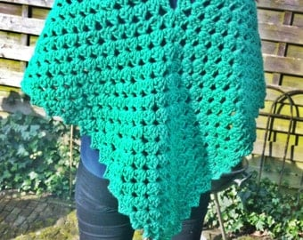 Crocheted green poncho