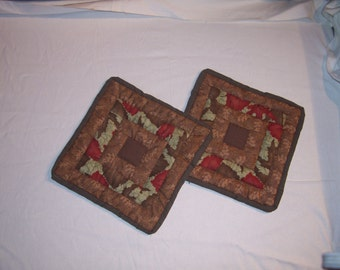 Potholders or small table mats, pair of insulated Autumn print potholders or small table mats.