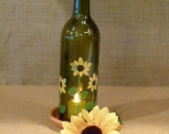 Unique, hand painted w/ sunflowers, wine bottle candle holder
