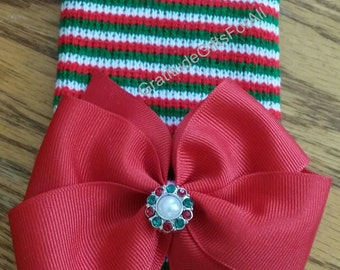 Newborn CHRISTMAS HOLIDAY hospital hat with a Beautiful red ribbon and topped off with a Smaller Christmas Rhinestone! CUTE!
