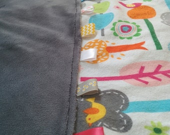 Soft and cuddly tag blanket for baby with minky and flannel. More options available. Free US shipping!