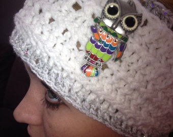 White and silver headwrap with owl jewel.