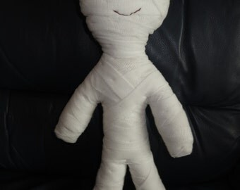 15 inch tall, handmade happy mummy, covered in bandages