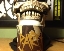 PARTY DUNGEON insulated can holder, genuinely haunted item, cozy but terrifying drink holder.