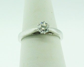 SALE * 18 K white gold and diamond solitaire engagement ring.