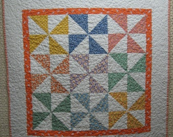 Free shipping in the U.S. on this beautiful 1930's Reproduction fabrics Pinwheel Baby Quilt with orange