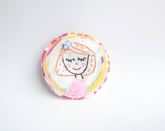 Zizu- fabric brooch with hand embroidery.