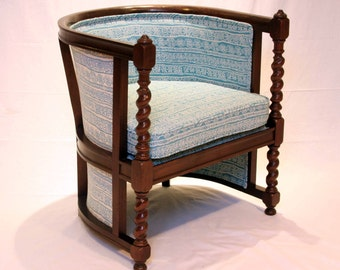 PRICE REDUCED.  Unique barrel chair with barley twist detail.  Reupholstered in blue & white batik woven pattern.