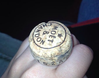 Champagne cork ring on adjustable base
