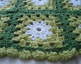 Green and white baby afghan