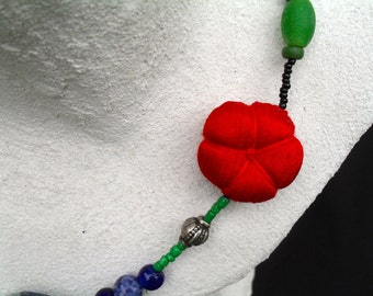 Necklace made from beads. handwoven Japanese textiles, cultured pearls. Indian silver, glass beads