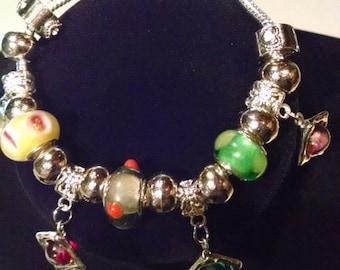 Diamond shaped dangles with lamp work glass beads