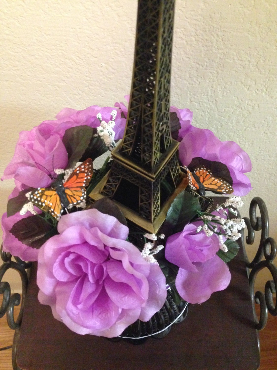 eiffel tower centerpiece with butterflies and flowers for a. Black Bedroom Furniture Sets. Home Design Ideas