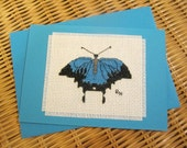 Hand cross stitched Australian native card - Ulysses Butterfly.  Blue coloured card with matching envelope and  white paper insert.