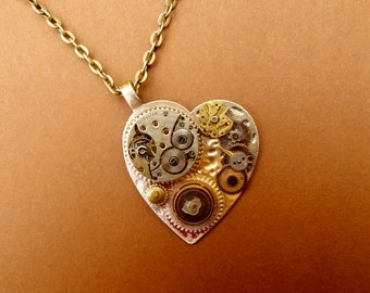 Unique Wearable Art Pendant Using Upcycled Watch Parts. Handmade in the UK.