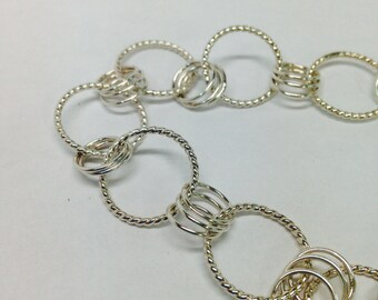 Heirloom quality, sterling silver twisted rope bracelet, with alternating trio of loops, handmade, with unique hand formed catch