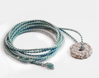 silver delicate round crochet pendant with silk cord