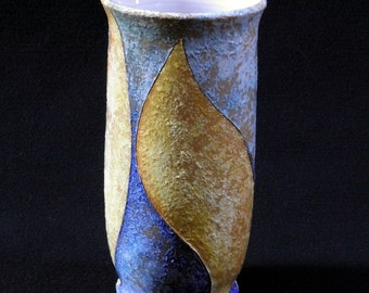 Flower vase shaped on the lathe and hand decorated with engobe technique and metal oxides. Single piece signed by me: m. Salem