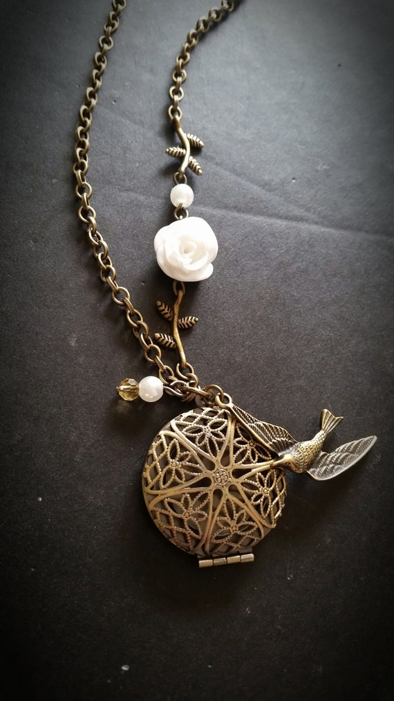 white and bird aromatherapy necklace essential
