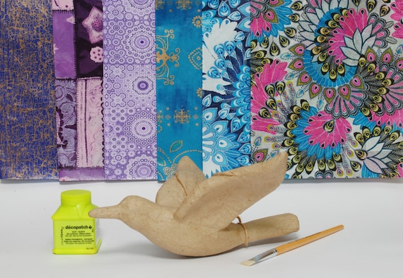 step by step instructions for a bird of papier mache