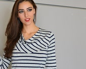 Striped women's top in heather gray and navy with soft cowl