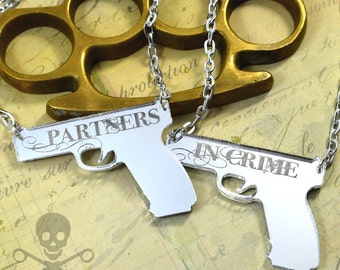PARTNERS IN CRIME - Double Guns Necklace Set in Silver Mirror Laser Cut Acrylic