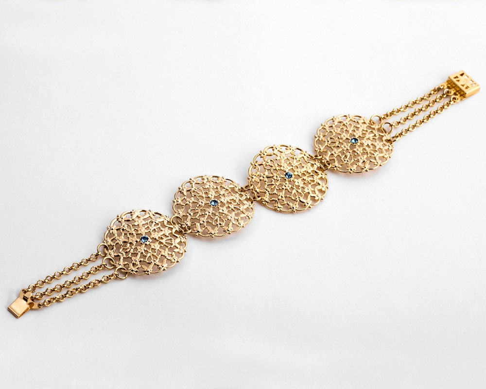 gold lace bracelet with blue crystals gold statement jewelry