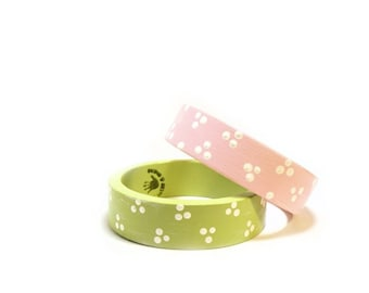 Set of 2 pastel wooden bracelets in green and pink with white polka dots