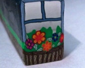 Raw Rustic Blue Window Cane with a Windowbox and Flowers