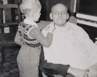 Vintage Photograph - Boy Painting a Mans Face